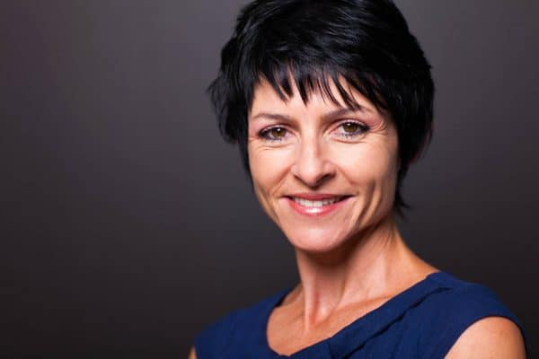 pretty middle aged woman closeup portrait on black