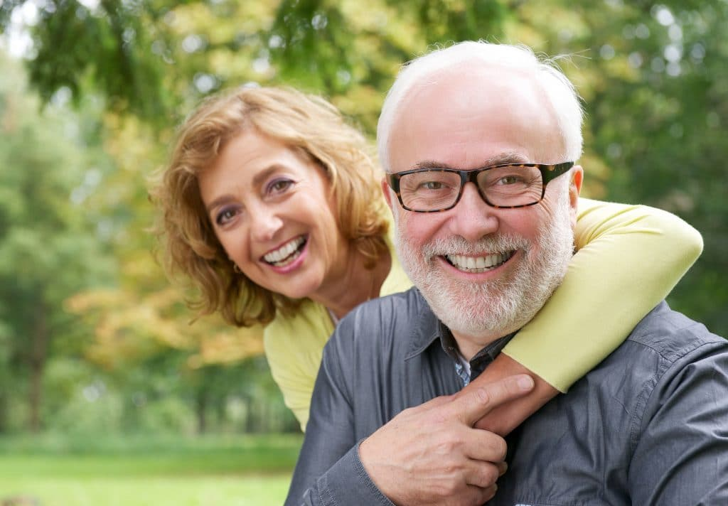 Closeup portrait of a happy older woman embracing smiling older man