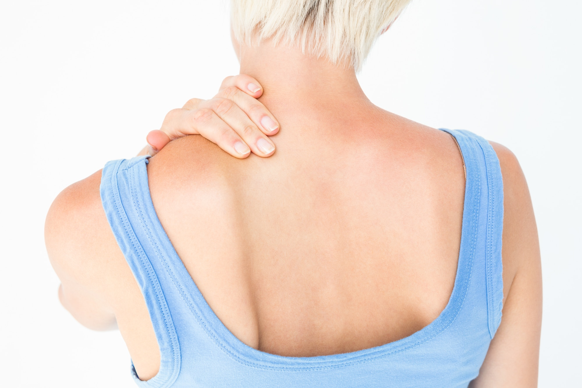 Casual woman with neck pain on white background